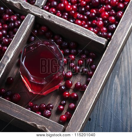 Fresh Cranberry Juice On The Wooden Table