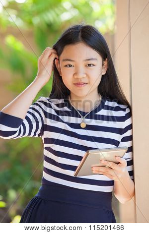 Portrait Of Asian Teen Age ,girl With Computer Tablet In Hand Standing With Happiness And Relax Emot