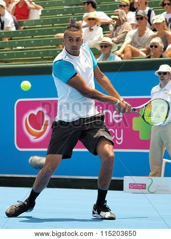 Nick Kyrgios plays a backhand
