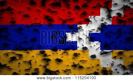 Flag of the Nagorno-Karabakh Republic painted on wall with bullet holes
