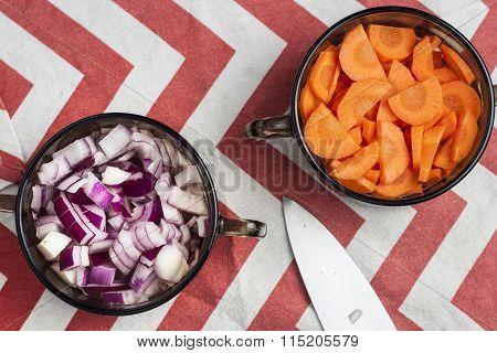 Sliced Carrot And Chopped Red Onion In Bowls