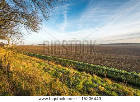 Plowed Field In A Colorful Dutch Landscape