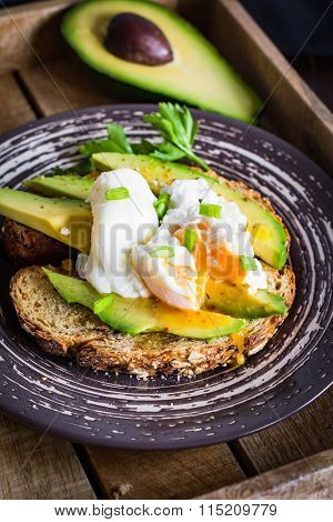 Avocado and poached egg toast. Healthy breakfast