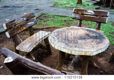 Concrete Chairs And Table In The Garden
