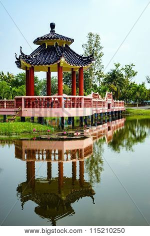 Beautiful Garden With Chinese Architecture Bridge And Reflection In The Lake