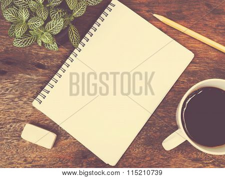 Notepad, Coffee And Green Plant