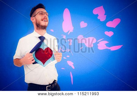 Geeky hipster opening shirt superhero style against blue background