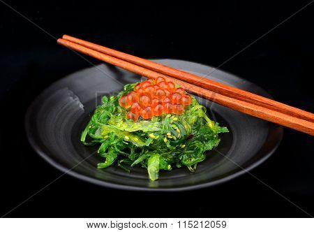 Japanese Style Raw Salmon Eggs With Seaweed Salad