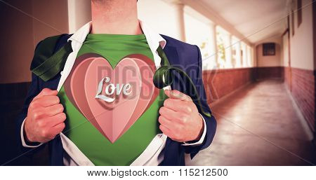 Businessman opening shirt in superhero style against hallway