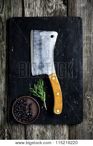 Wooden cutting board and old meat cleaver