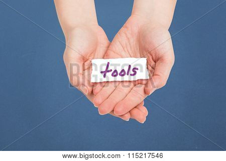 Hands presenting against tools