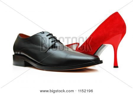 Black Male Shoe And Red Female Shoe Isolated On White