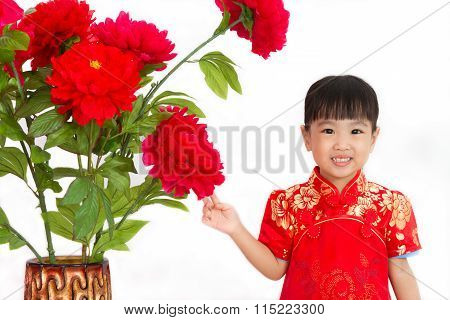 Chinese Little Girl Wearing In Red Posing With Flowers