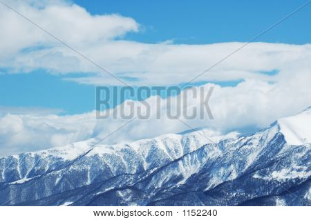 Mountains Under Snow In Bright Winter Day