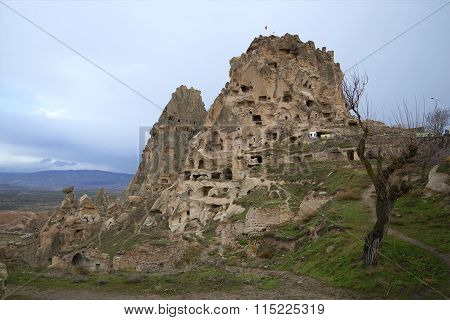 View of the Uchisar castle on a cloudy january day. Cappadocia