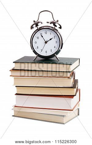 Alarm Clock With A Stack Of Books