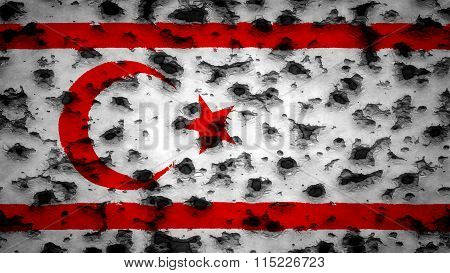 Flag of Northern Cyprus painted on wall with bullet holes