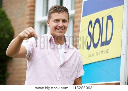 Man Outside New Home Holding Keys