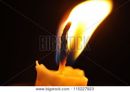 Candle With Flame In Dark Background