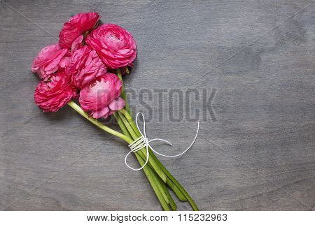 Some Peonies On Wooden Background.
