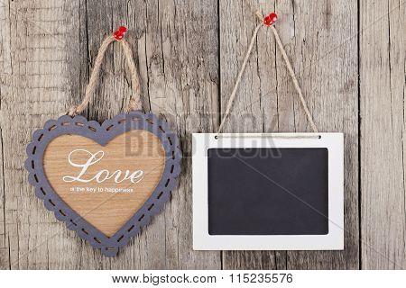 Empty Wooden Blackboard Sign And Heart Shape Frame