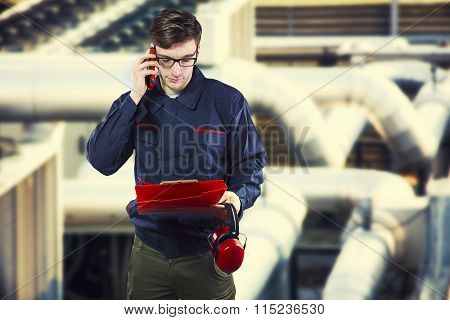 Worker In Protective Uniform With Smartphone