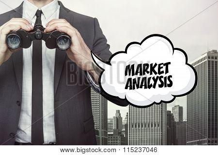 Market analytics text on speech bubble with businessman holding binoculars