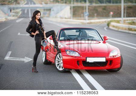girl near red car