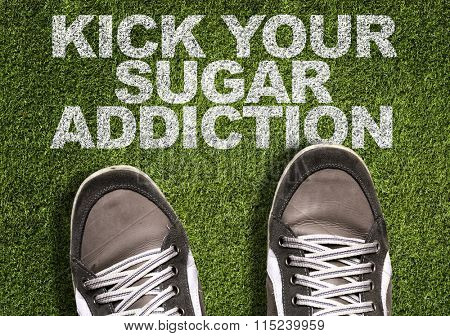 Top View of Sneakers on the grass with the text: Kick Your Sugar Addiction