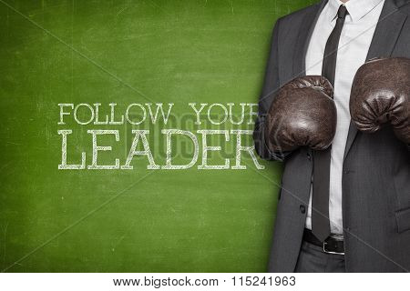 Follow your leader on blackboard with businessman on side