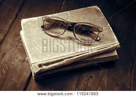Vintage Reading Glasses On The Books Stack