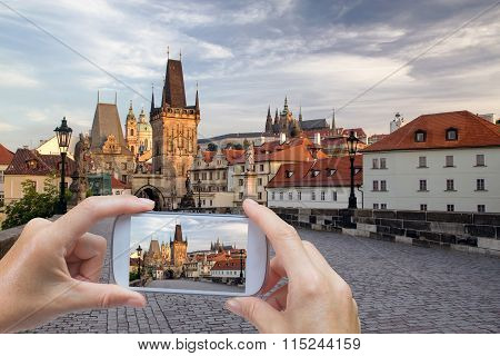 Taking Pictures By Smart Phone In Charles Bridge (prague)