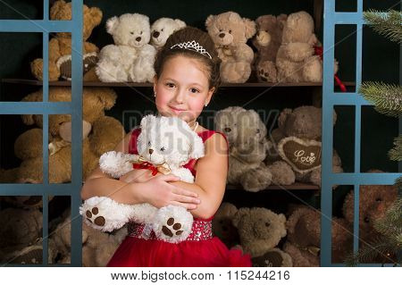 Girl In A Red Dress Hugging A Teddy Bear