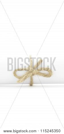 Handmade Natural Rope Bow Tied On White Letter Scroll Isolated