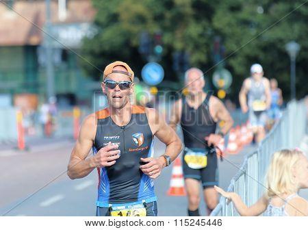 Closeup Of Running Older Men In Bright Sunlight