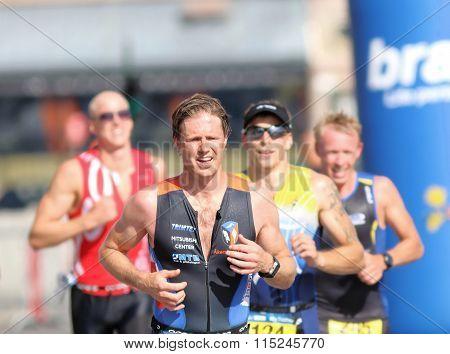 Closeup Of Group Of Running Men In Bright Sunlight
