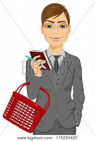 business man holding an empty shopping basket
