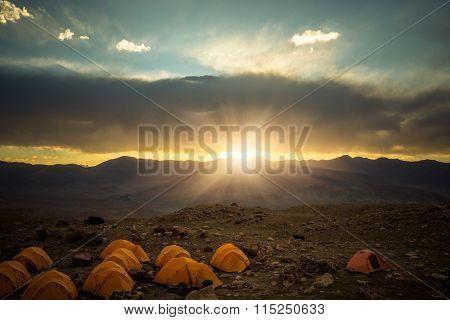 camp tents in sunrise, peaks of Muztagh Ata,china.