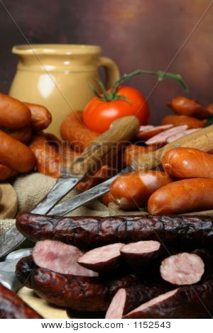 Composition Of Sausages With Knives
