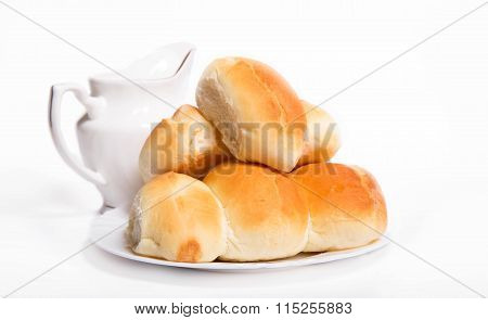 House Pastries: Pies On A White Plate Near A White Jug