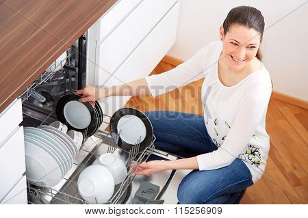 Young Woman Empty Out The Dishwasher 2