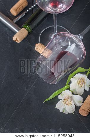 Bottle Of Red Wine, Glass, Corks And Corkscrew