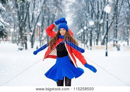 Beautiful Winter Portrait Of Young Woman In The Winter Snowy Scenery. Dancing Girl