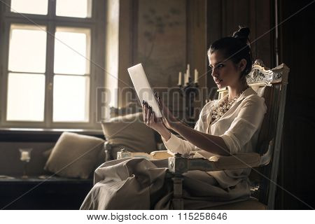 Rich woman using a tablet