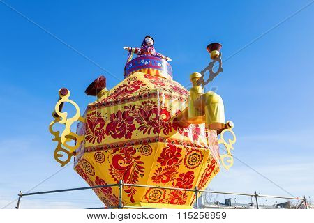 Shrovetide In Russia. Big Improvised Samovar Against The Blue Sky