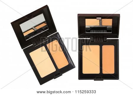 Closeup photo of a concealer palettes in different shades to conceal under-eye circles or facial blemishes, isolated on white