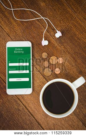 Online banking against view of a white smartphone with a cup of coffee