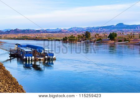 January 16, 2016 in Laughlin NV:  Cluster of docked Water Taxis on the Colorado River where tourists can ride from casino to casino surrounded by the beautiful desert landscape taken in Laughlin, NV