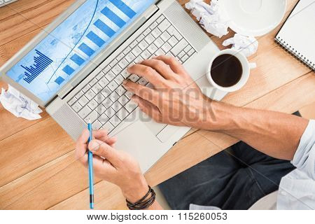 Blue data against hands working with blank screen laptop