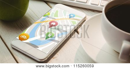 Navigation pointers with various representations on map against smartphone on desk